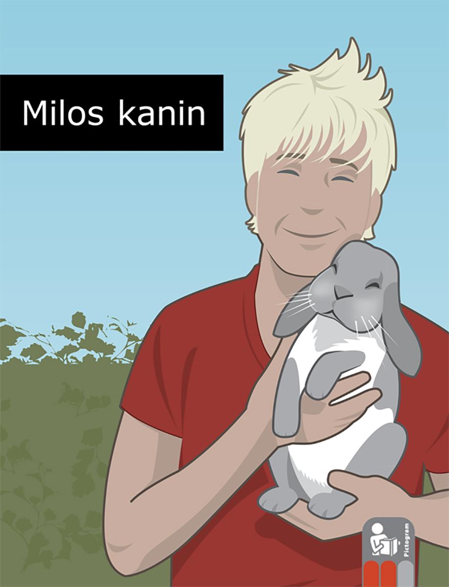 Glad pojke håller i en glad kanin.