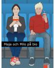 Glad pojke och flicka sitter i en biograf.