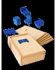 Formlådan, en trälåda med tillhörande möbler i trä. För att öva samband mellan två- och tredimensionella former.