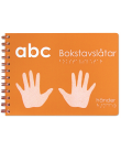 En orange ABC bok med en hand på framsidan.