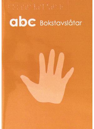 En orange ABC bok med bokstavslåtar, med en hand på framsidan.