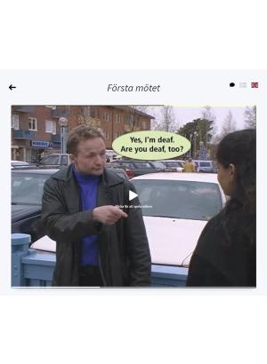 En man frågar en person pekar på en annan person med ryggen mot kameran. En pratbubbla med texten yes I am deaf. Are you deaf too?